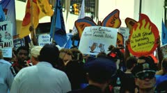 Large crowd protests at charlotte democratic national convention 2012 Stock Footage