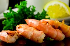 grilled prawns on black background - stock photo