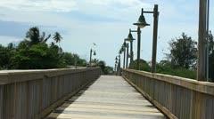 Wood pedestrian bridge on waterfront at San Juan Bay 1 Stock Footage