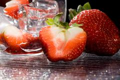 strawberries on ice - cocktail dessert - stock photo
