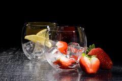 strawberries and lemon on ice - cocktail dessert - stock photo