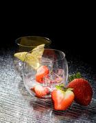 strawberries and lemon on ice - cocktail dessert - stock photo