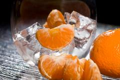 mandarins on ice - cocktail dessert - stock photo