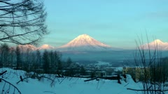 The huge volcano in the twilight of winter day, the sun shines its ice slopes Stock Footage