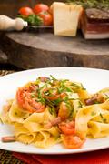 pasta with bacon and tomatoes - stock photo