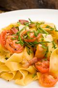 Stock Photo of pasta with bacon and tomatoes
