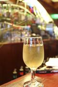Glass of White Wine On Bar - stock photo