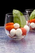 tomato mozzarella appetizer in glass - caprese - stock photo