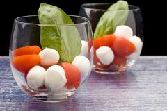 Stock Photo of tomato mozzarella appetizer in glass - caprese