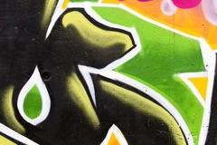Green graffiti on a wall Stock Illustration