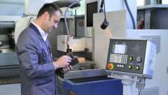 Metalworker operates CNC machine - 2 - stock footage