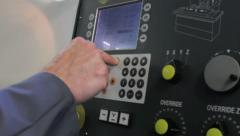Metalworker operates CNC machine - closeup panel - 2 - stock footage