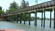 Wood pedestrian bridge on waterfront 3 Stock Footage
