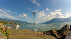 Modern sculpture - a fork sticking out of Lake Geneva Stock Footage