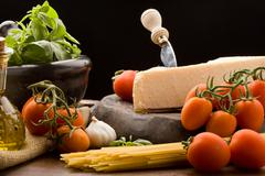 ingredients for pasta with tomatoe sauce - stock photo