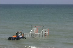 Lifeboat returns to amphibious launch tractor  Stock Footage