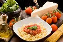 Pasta with tomatoe sauce and ingredients Stock Photos
