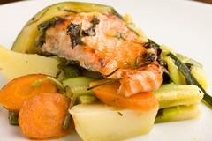 Baked salmon with vegetables Stock Photos