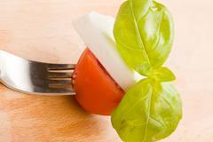 Fork with tomatoe and mozzarella Stock Photos