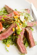 meat with rocket salad - stock photo