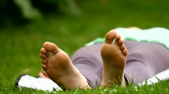 Girl feet, lying down in the park Stock Footage