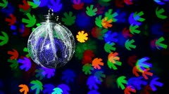 New Year decorations ball on blinking snowflake shaped bokeh background Stock Footage