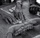 Hands playing dominoes Stock Photos