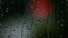 Autumn rain drops on a window, red out of focus lights Stock Footage