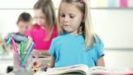 Cute kindergarten girl smiles at camara Stock Footage