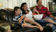 Family watching a scary movie Stock Footage