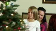 Cute little girls next to Christmas tree Stock Footage