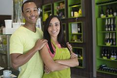 Business owners standing in shop - stock photo