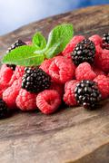 Berries on wooden table Stock Photos