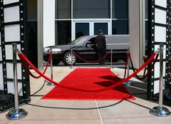 Red carpet and limousine - stock photo