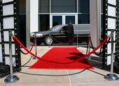 Stock Photo of Red carpet and limousine