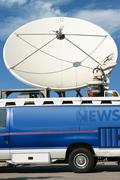 News truck transmits signal - stock photo