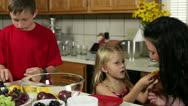 Kids playing in the kitchen with mom Stock Footage