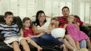 Large family watching TV Stock Footage