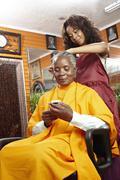 Woman having hair done in beauty salon Stock Photos