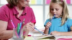 Teacher helping the kindergarten student - stock footage