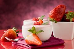 Strawberry yogurt with mint leaf Stock Photos