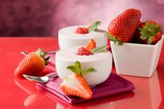 strawberry yogurt with mint leaf - stock photo
