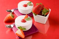 Strawberry yogurt with mint leaf Stock Photos