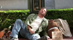 Homeless Man Receiving Money from Passerby - Model Released Stock Footage