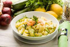 Stock Photo of pasta with zucchini and shrimps