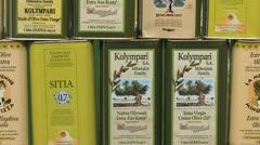 Olive oil tins at a market in Crete, Greece Stock Footage