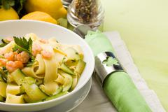 pasta with zucchini and shrimps - stock photo