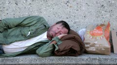 Homeless Man Sleeping on a Bench - Model Released Stock Footage
