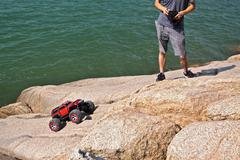 Rc toy car on a stone terrain Stock Photos