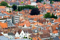 roofs of flemish houses in brugge, belgium - stock photo